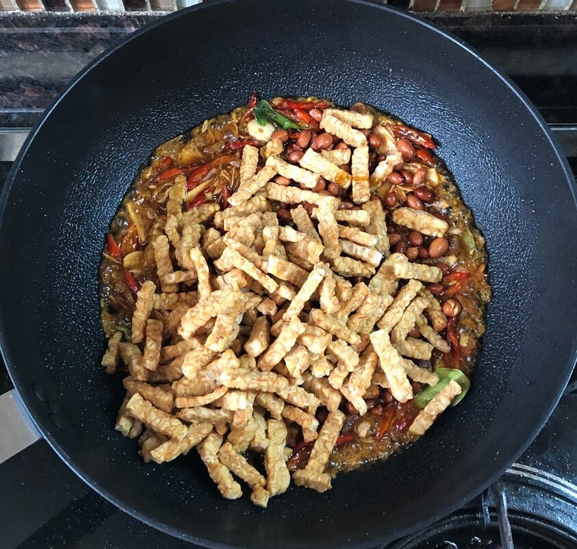 Add the tempeh and peanuts
